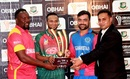 Hamilton Masakadza, Shakib Al Hasan and Rashid Khan pose with the T20I trophy, September 12, 2019
