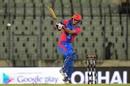 Najibullah Zadran smashes it during an aggressive innings, Afghanistan v Zimbabwe, 2nd match, Bangladesh T20I tri-series, Mirpur