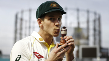 Tim Paine plants a kiss on the Ashes urn after defeat in the final Test at The Oval