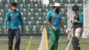 Coach Misbah-ul-Haq chats with Ahmed Shehzad during a training session