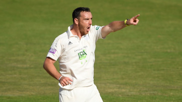 Kyle Abbott celebrates the wicket of Craig Overton