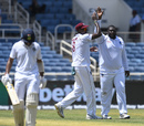Jason Holder and Rahkeem Cornwall celebrate the dismissal of Cheteshwar Pujara, day 1,  second Test, West Indies v India, Sabina Park, Kingston, Jamaica, August 30, 2019