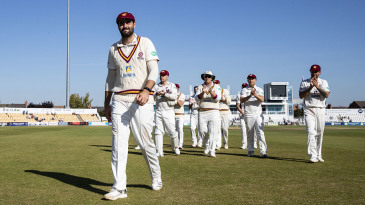 Brett Hutton of Northamptonshire is applauded by his team-mates