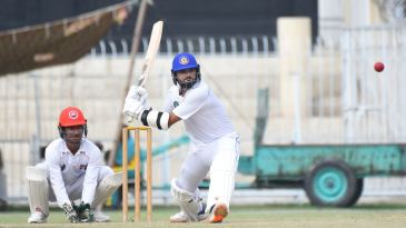 Central Punjab's Azhar Ali gets into position to sweep