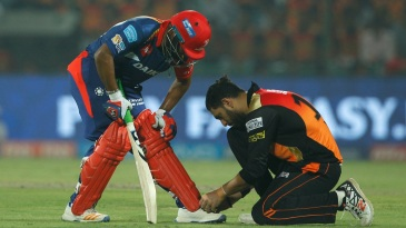 Rishabh Pant gets his shoelaces sorted by Yuvraj Singh during an IPL 2017 game