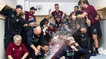 Northamptonshire celebrate after their promotion to Division One is confirmed