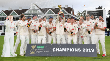Ryan ten Doeschate lifts the County Championship trophy as his Essex team-mates celebrate