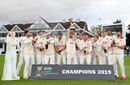 Ryan ten Doeschate lifts the County Championship Division One Trophy as his Essex team-mates celebrate, Taunton, September 26, 2019