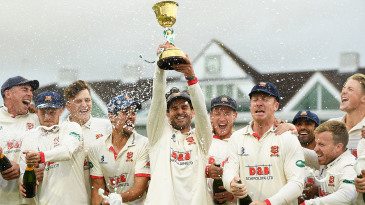 Ryan ten Doeschate lifts the County Championship Division One Trophy as Essex celebrate