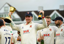 Simon Harmer of Essex celebrates with the County Championship Division One Trophy, Taunton, September 26, 2019