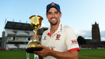 Alastair Cook poses with the County Championship trophy