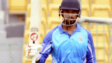KL Rahul raises his bat after getting to a hundred