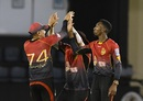 The master and the apprentice: Sunil Narine and Khary Pierre celebrate a wicket