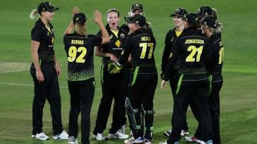 Megan Schutt celebrates with her team-mates