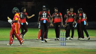 Amjad Mahboob, the Singapore captain, celebrates the wicket of Brian Chari