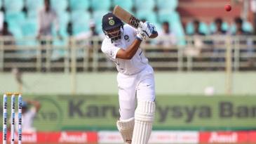 Hanuma Vihari uses his feet to get close to the ball and drive