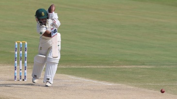 Temba Bavuma drives straight back down the wicket