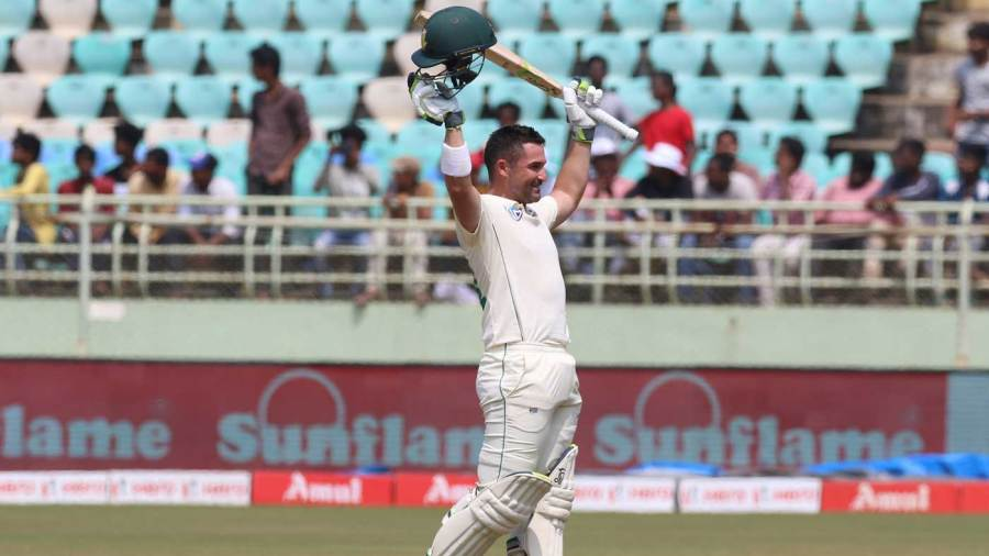 Dean Elgar raises his bat after getting a century