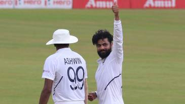 Ravindra Jadeja gives a thumbs-up to the dressing room