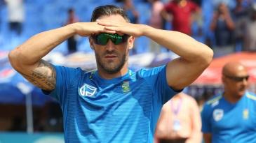 Faf du Plessis looks on