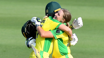 Alyssa Healy gets a hug from Meg Lanning after reaching her century