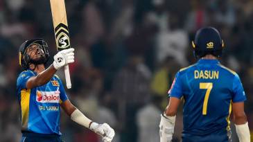 Oshada Fernando looks at the heavens after bringing up fifty