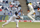 A close-in fielder is airborne as Mayank Agarwal drives, India v South Africa, 2nd Test, Pune, 1st day, October 10, 2019