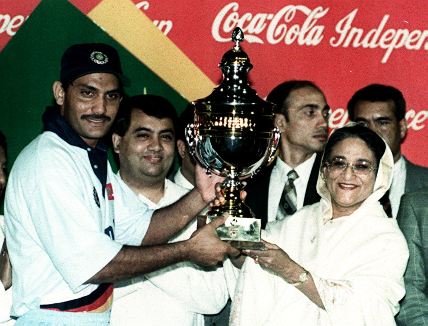 India captain Mohammad Azharuddin receives the 1998 Independence Cup from Bangladesh prime minister Sheikh Hasina in Dhaka