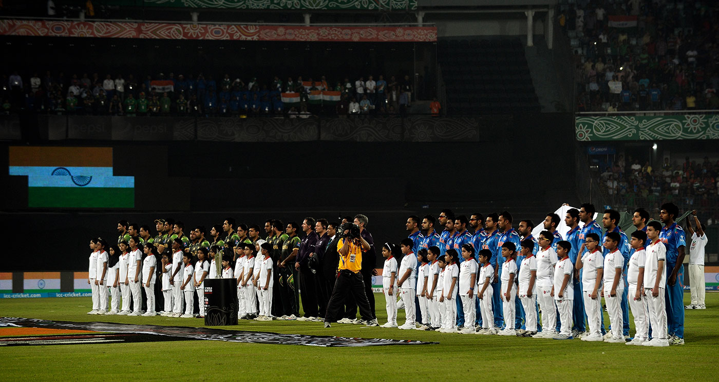 The players line up for the national anthems