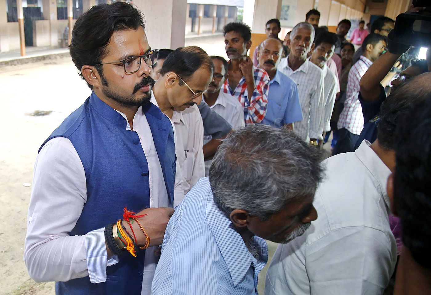 Sreesanth waits in line to vote in 2016 - the year he was also the BJP candidate from Trivandrum