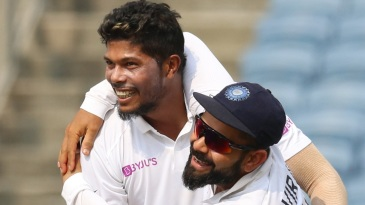 Umesh Yadav and Virat Kohli celebrate a wicket