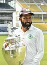 Wasim Jaffer poses with the trophy
