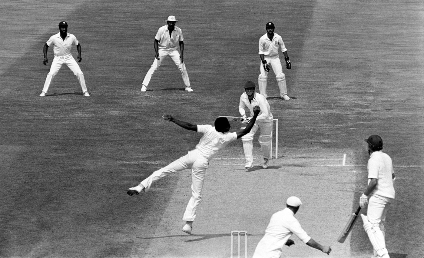 Jeff Dujon, Clive Llloyd and Viv Richards watch as Michael Holding takes a catch off his own bowling to dismiss Pat Pocock