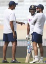 Ravi Shastri, Rohit Sharma and Virat Kohli chat during a practice session, Ranchi, October 18, 2019