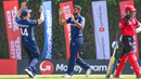 Safyaan Sharif gets a high five after bowling Surendran Chandramohan for 51, Scotland v Singapore, T20 World Cup Qualifier, Dubai, October 18, 2019