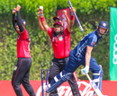 Singapore's Aritra Dutta rips out the stumps with ball in hand to end the match, Scotland v Singapore, T20 World Cup Qualifier, Dubai, October 18, 2019