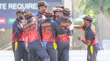 Norman Vanua is mobbed after taking a hat-trick against Bermuda in PNG's opening match