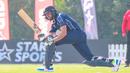 Calum MacLeod completes a sweep through the leg side, Kenya v Scotland, T20 World Cup Qualifier, Dubai, October 19, 2019