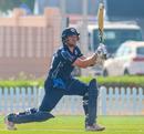 Richie Berrington drives over extra cover for a boundary, Kenya v Scotland, T20 World Cup Qualifier, Dubai, October 19, 2019