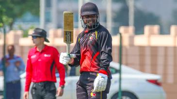 Tony Ura raises his bat after reaching a half-century
