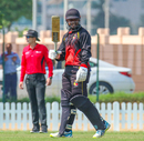 Tony Ura raises his bat after reaching a half-century, Namibia v Papua New Guinea, ICC T20 World Cup Qualifier, Dubai, October 20, 2019
