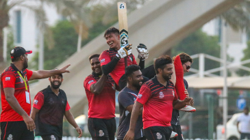 Navin Param is carried off the field after his unbeaten 72 off 41 balls took Singapore home