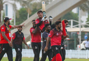 Navin Param is carried off the field after his unbeaten 72 off 41 balls took Singapore home, Bermuda v Singapore, ICC Men's T20 World Cup Qualifier, Dubai, October 20, 2019