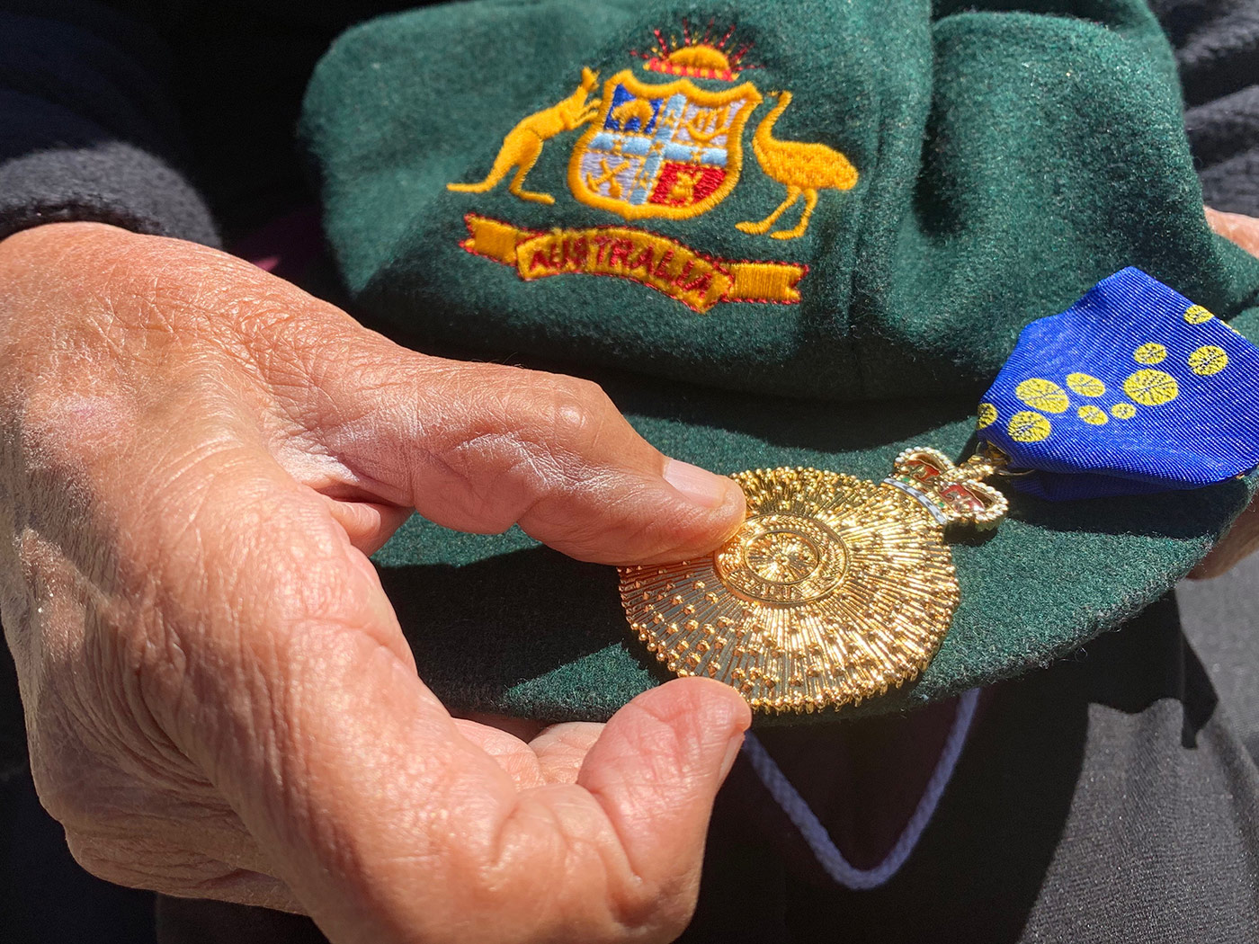 The goods: Thomas displays her baggy green and her Order of Australia medal