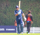 Kyle Coetzer raises his bat after reaching a half-century, Papua New Guinea v Scotland, ICC Men's T20 World Cup Qualifier, Dubai, October 21, 2019