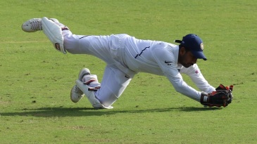 Wriddhiman Saha collects low to his left