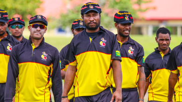 PNG captain Assad Vala leads his team off the field