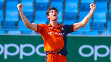 Brandon Glover lets out a roar to celebrate his first wicket