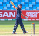 George Munsey raises his bat to the Scotland dugout after reaching a half-century, UAE v Scotland, ICC Men's T20 World Cup Qualifier playoff, Dubai, October 30, 2019