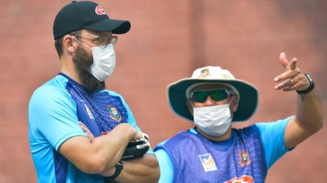 Daniel Vettori and Russell Domingo wearing face masks during a practice session